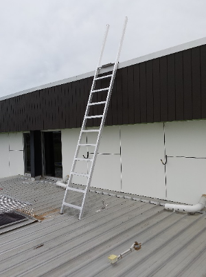 Portable Ladder erected on ladder safety bracket